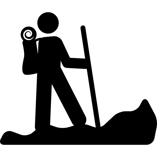 Hiking person silhouette with a stick  free icon