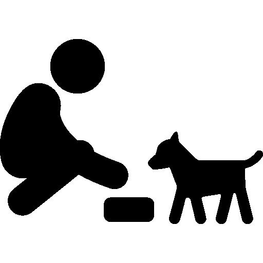 Feeding a dog  free icon